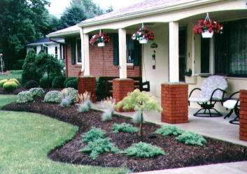 Landscaping in front of low porch
